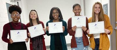 Raider cheerleaders earn individual region and state honors