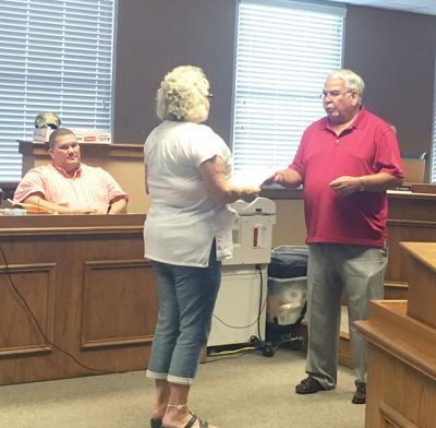 Sammy Carter presents a resolution honoring Debbie Dudley