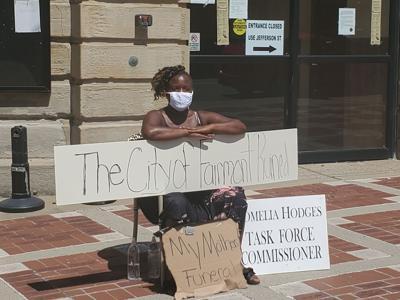 Romelia Hodges protesting