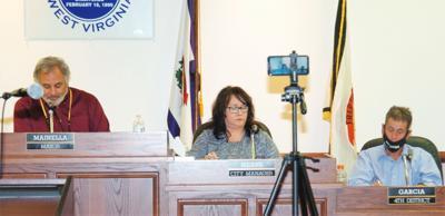 Fairmont City Manager Valerie Means, center, at City Council meeting