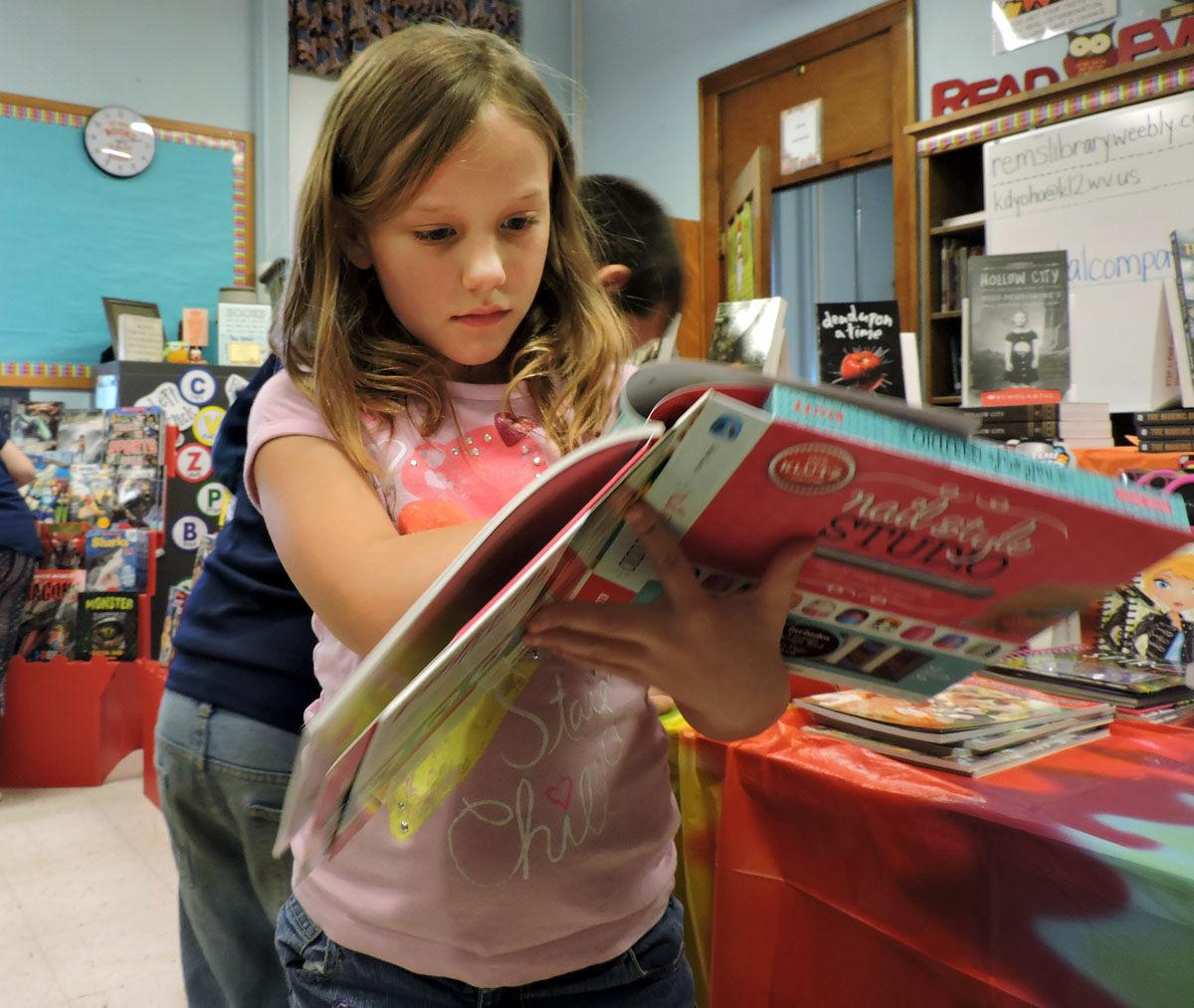 A Third Grade Student Reads Book About Nail Art At The Rivesville Elementary Middle School Buy One Get Free Fair On Friday
