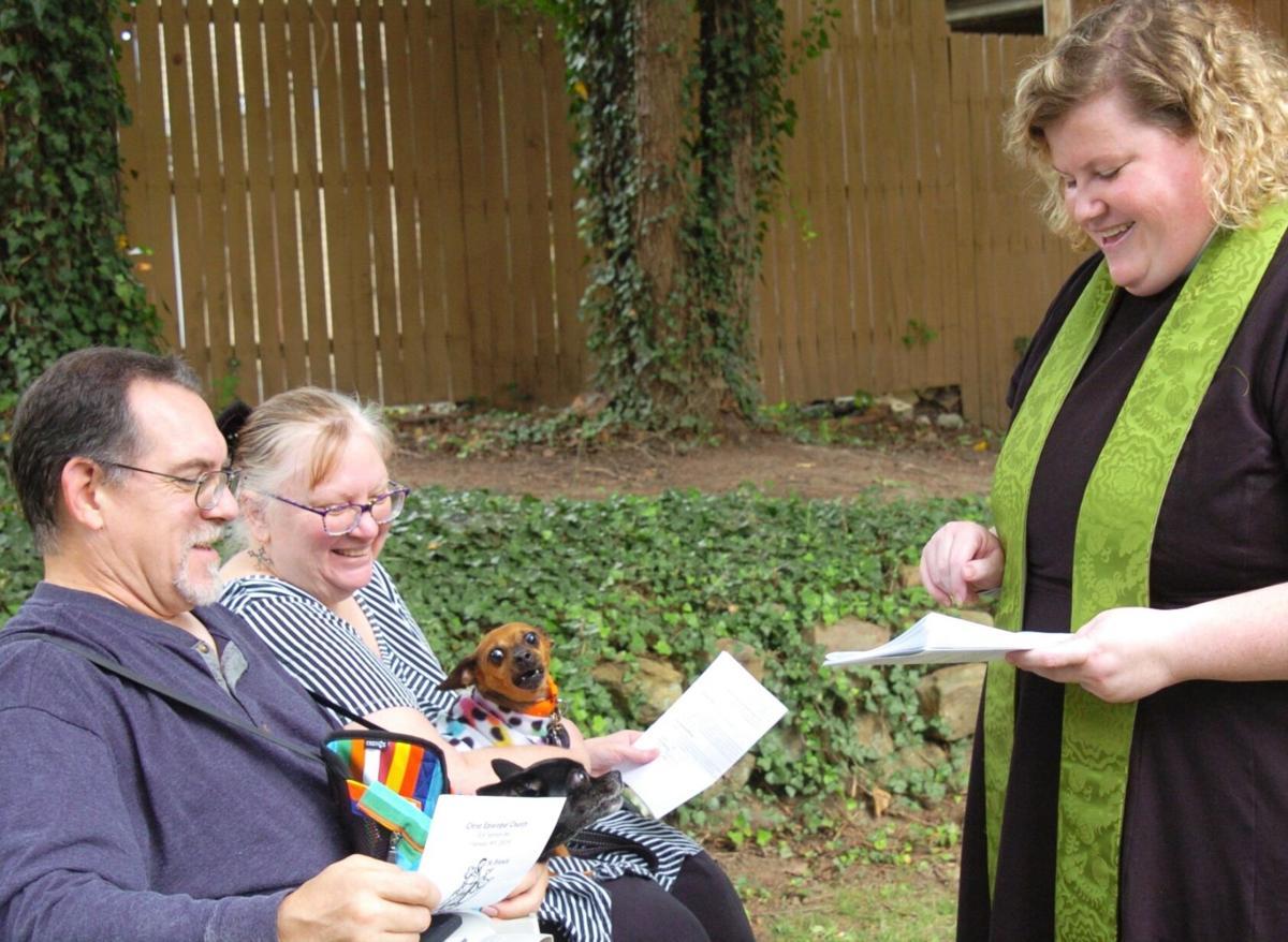 Rev. Jordan Trumble blesses animals at Sunday's service
