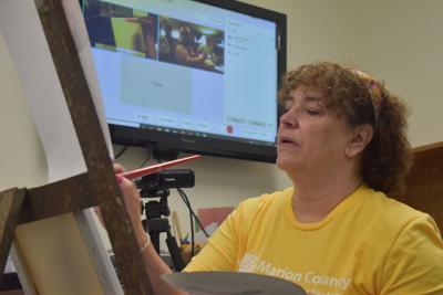 Julie Mike teaching a virtual painting class.