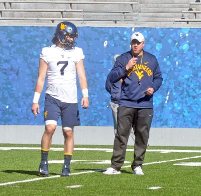 495db88c1 WVU quarterback Will Grier talks with offensive coordinator Jake Spavital  during practice in Morgantown.