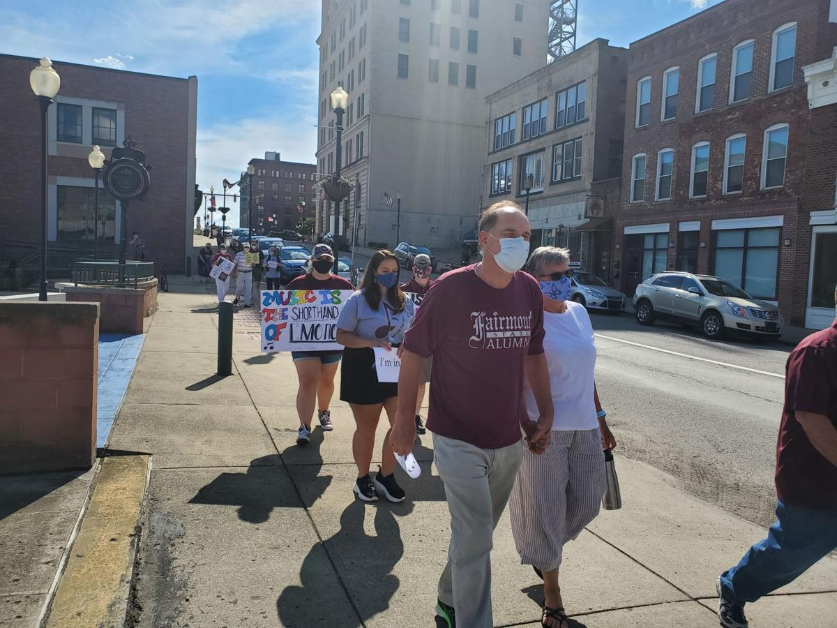 Arts advocates take to the streets of Fairmont in aftermath of university program cuts