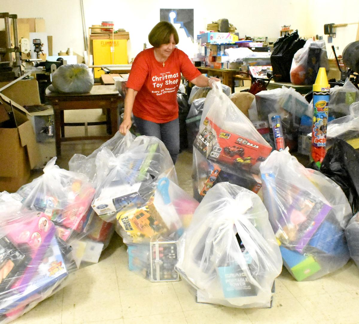 Sharon Putting out toys -ts.jpg