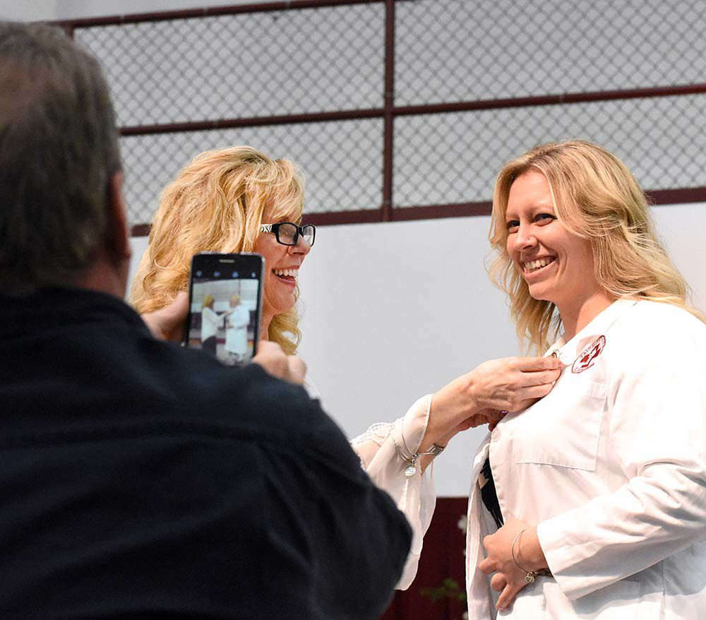 FSU nursing students receive pin emblematic of