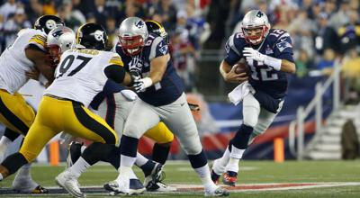 Steelers Patriots Football. New England Patriots quarterback Tom Brady (12) scrambles  against the Pittsburgh Steelers Thursday in ... b98def347