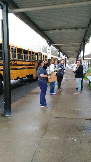 Volunteers pack bus