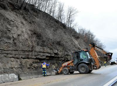 Early morning mud slide forced traffic to one lane