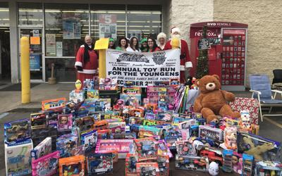 employees from family dollar on east park avenue in fairmont pose with santa and mrs claus with the toys collected before the toy run saturday - Family Dollar Open On Christmas