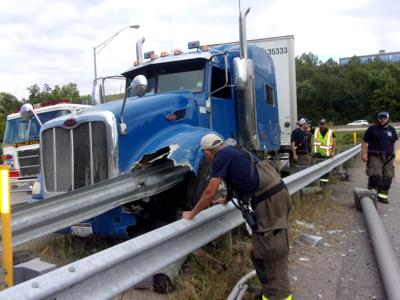 Tractor-trailer strikes guardrail