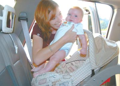 Jama Schwartz Places Her 3 Month Old Son Graison Into His Rear Facing Car Seat Before Leaving Home West Virginia Law Requires All Children From Birth To 8