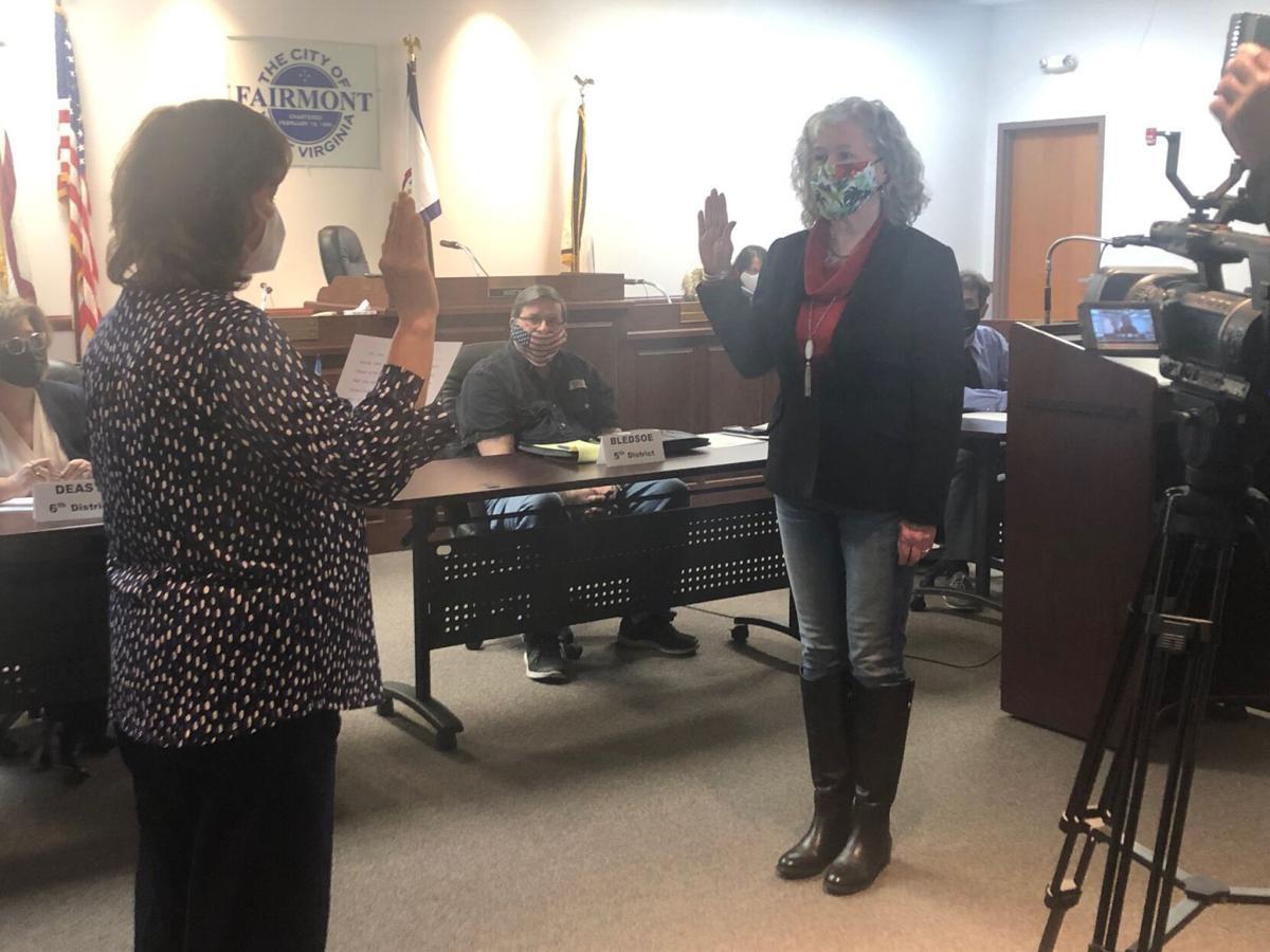 Deputy mayor takes oath.