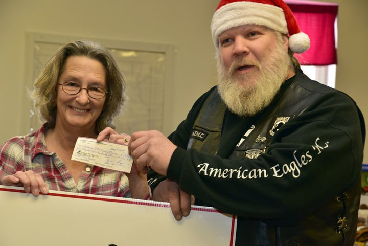 Motorcycle club donates children's gifts