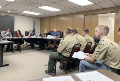 Boy Scouts participate in council meeting