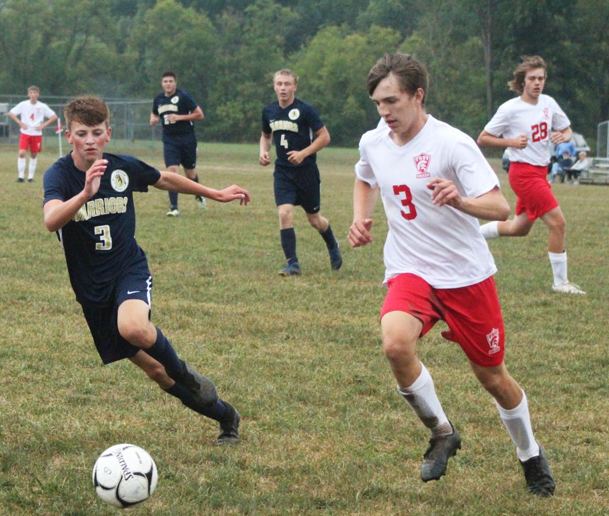 Williamson soccer player hustles for ball
