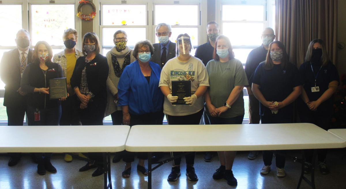 PIP, Food Bank, Housing Authority pose with plaque