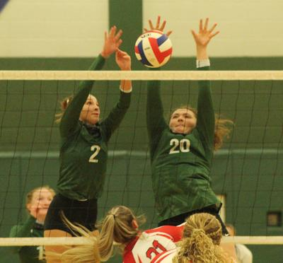 Hornets volleyball players meet ball at net