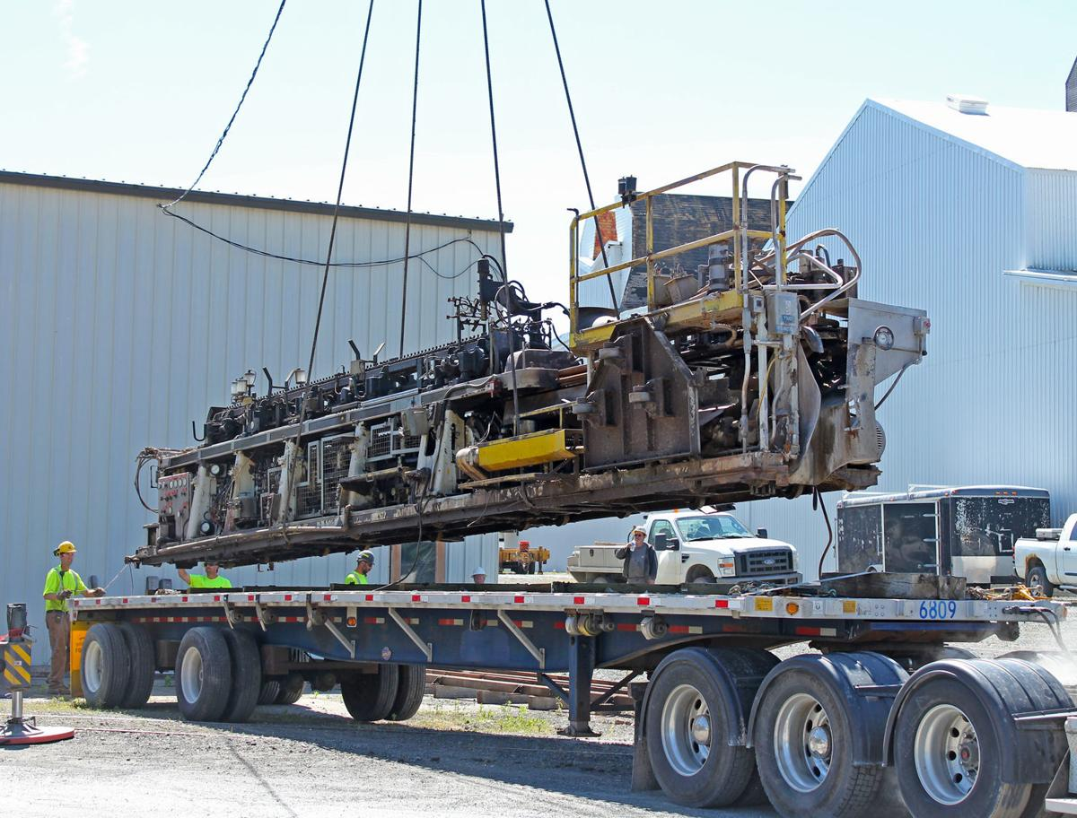 Ribbon machines lifted from truck bed