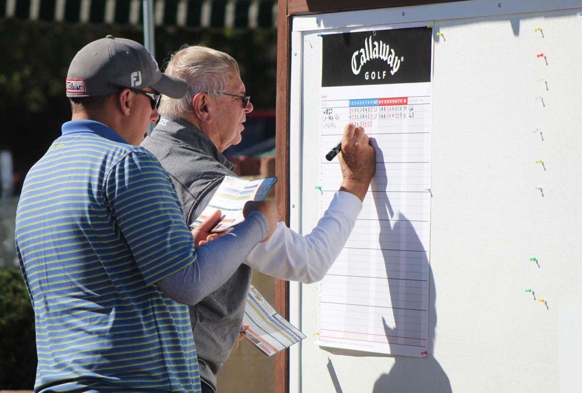 Golfer write down scores
