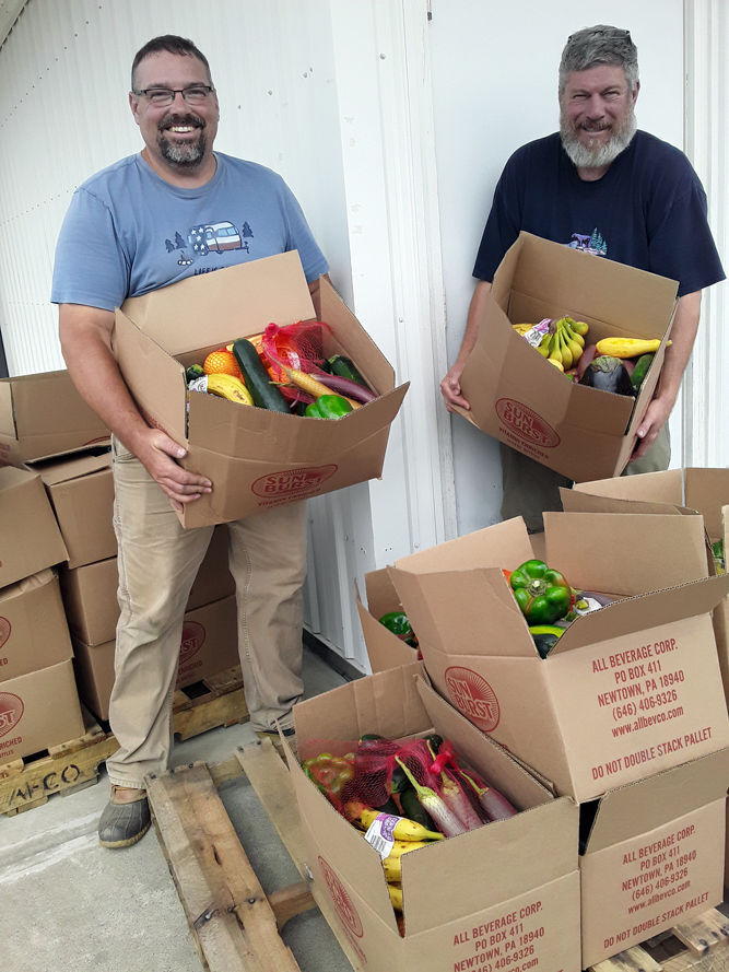 Hundreds turn out for produce give-away
