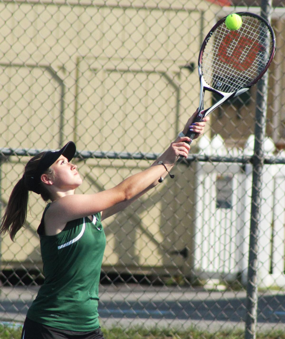 Wellsboro tennis player returns the ball