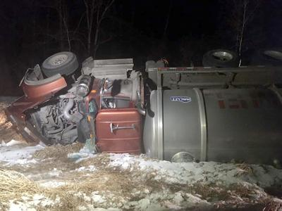 Tanker truck rolls over
