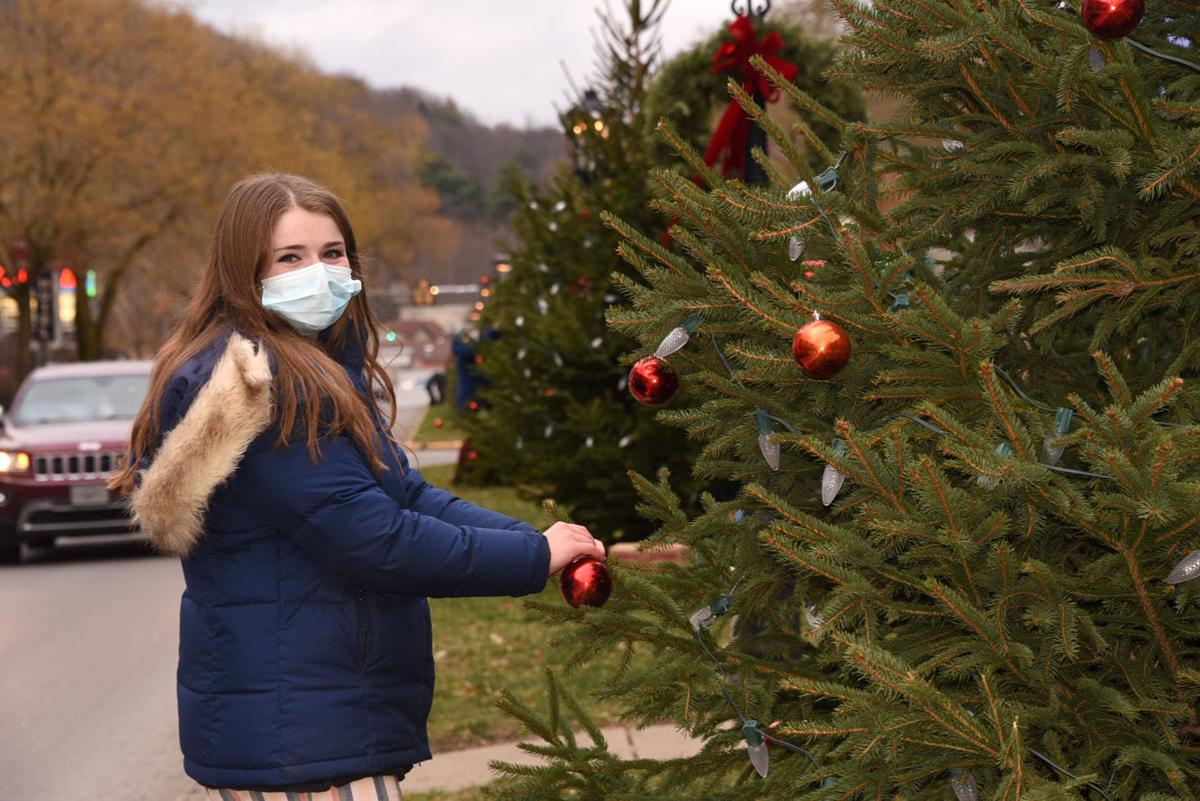 Teachers decorate trees