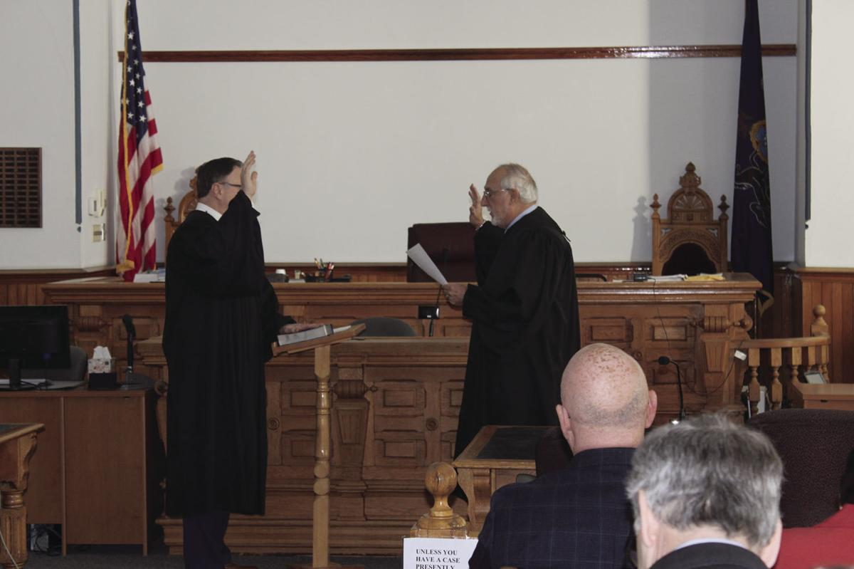 Swearing in the judge to swear in the rest