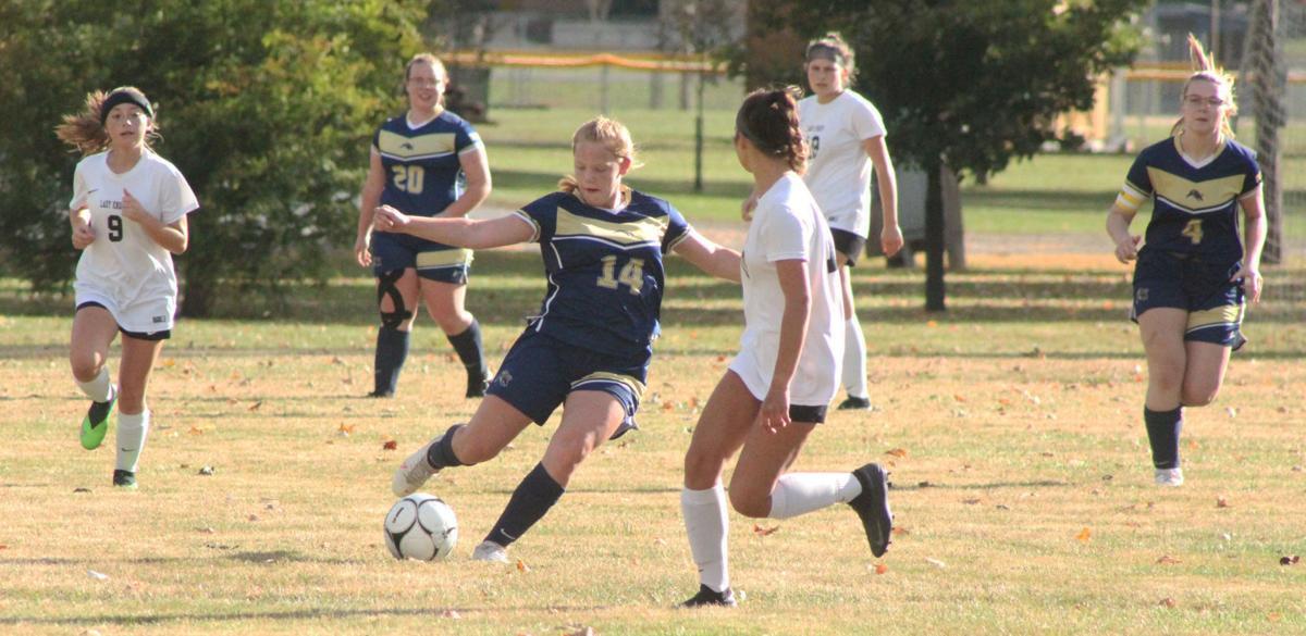 Nikki Kiscadden dribbles ball