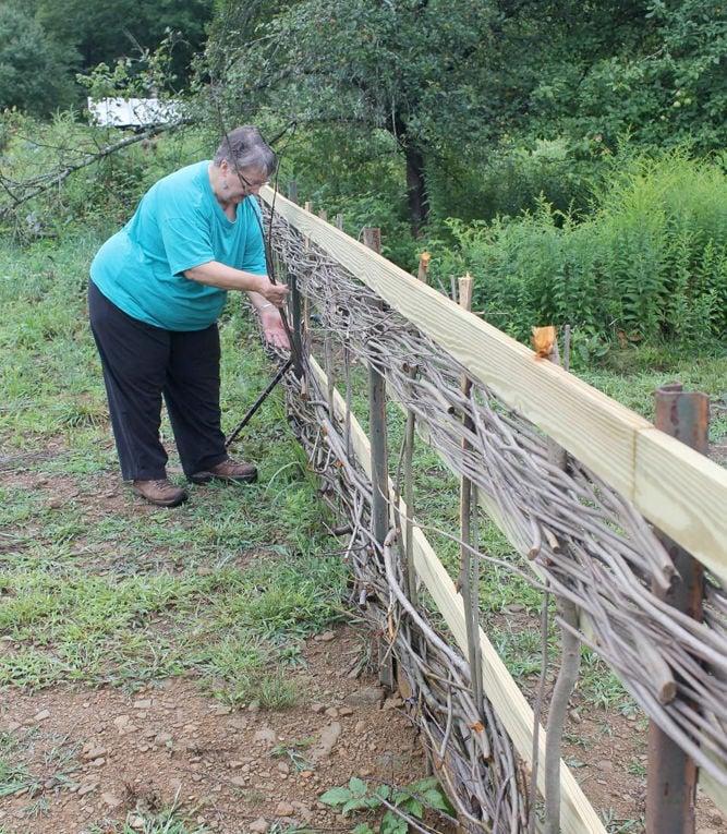 Fence weaver describes craft