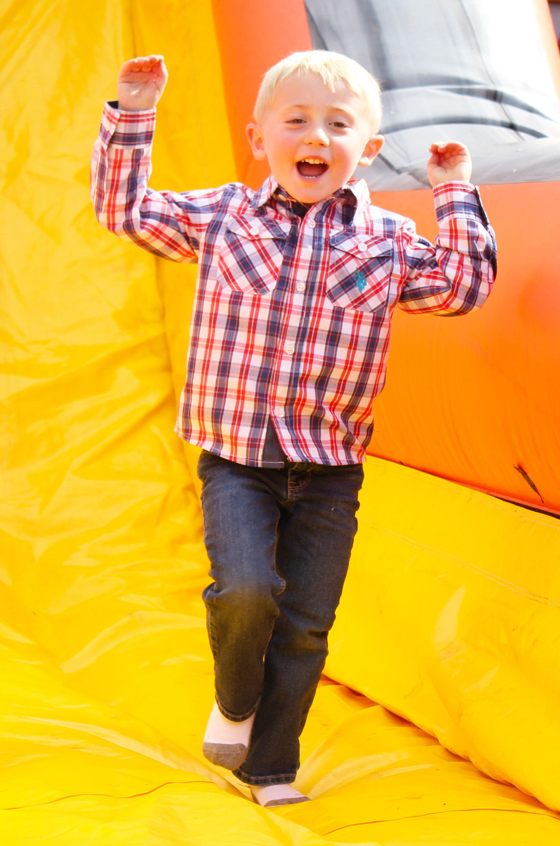 Bouncy house and slide bring smiles