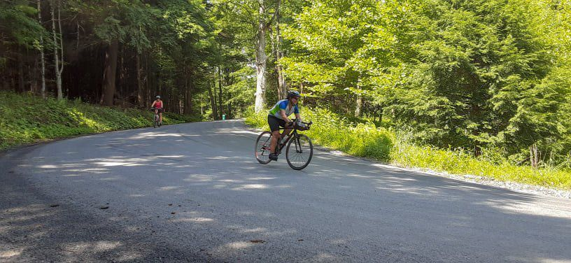 Bicyclists travel down the Rail Trail during the GT-105 Gravel Ride