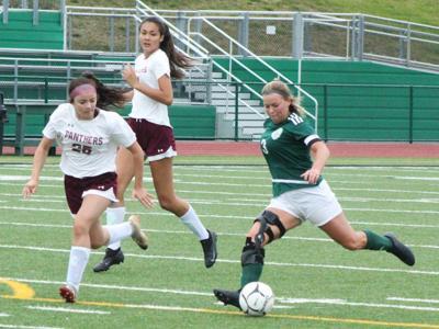 Kerrah Clymer hits goal against NEB