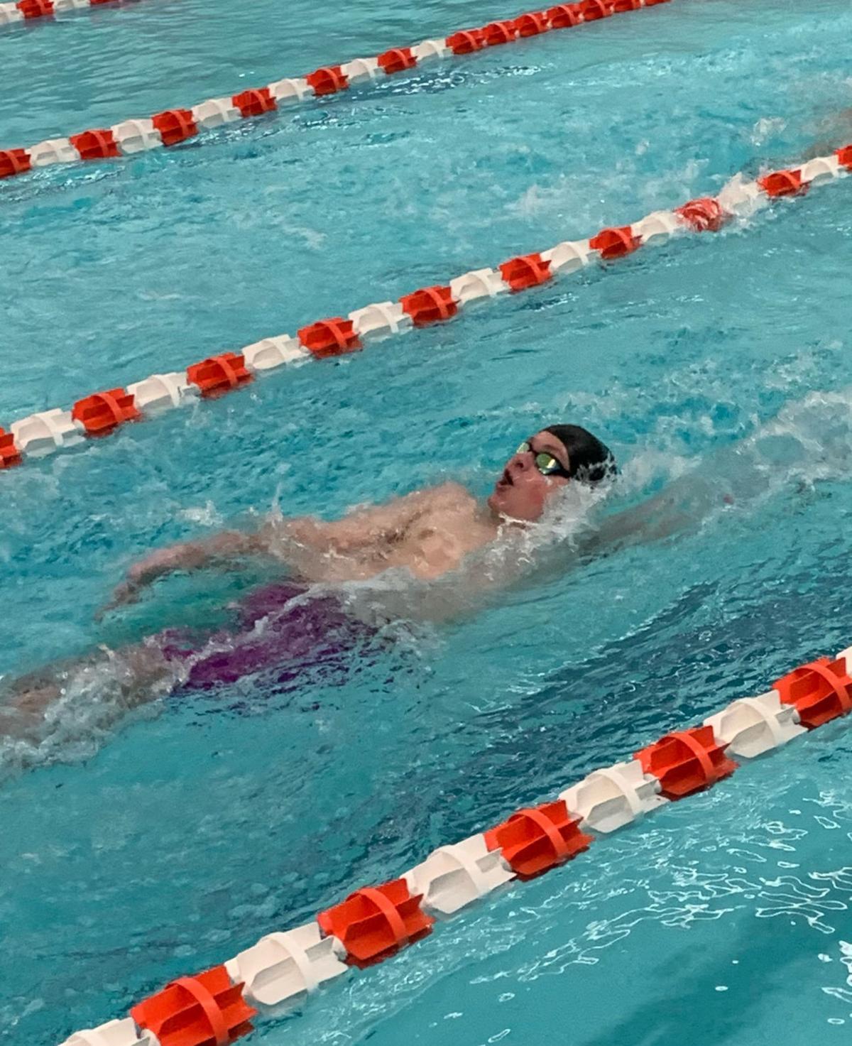 Webster performs backstroke