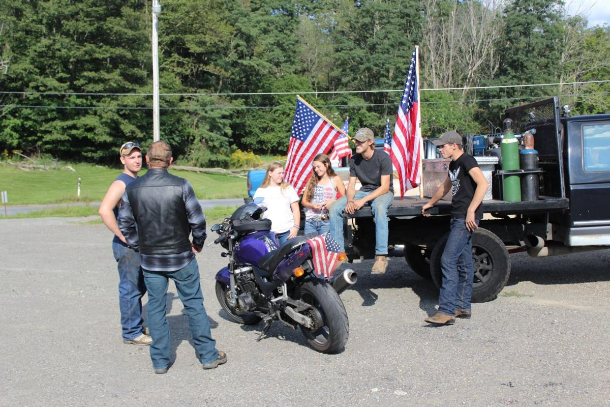 Young patriots prepare for a 9-11 truck parade