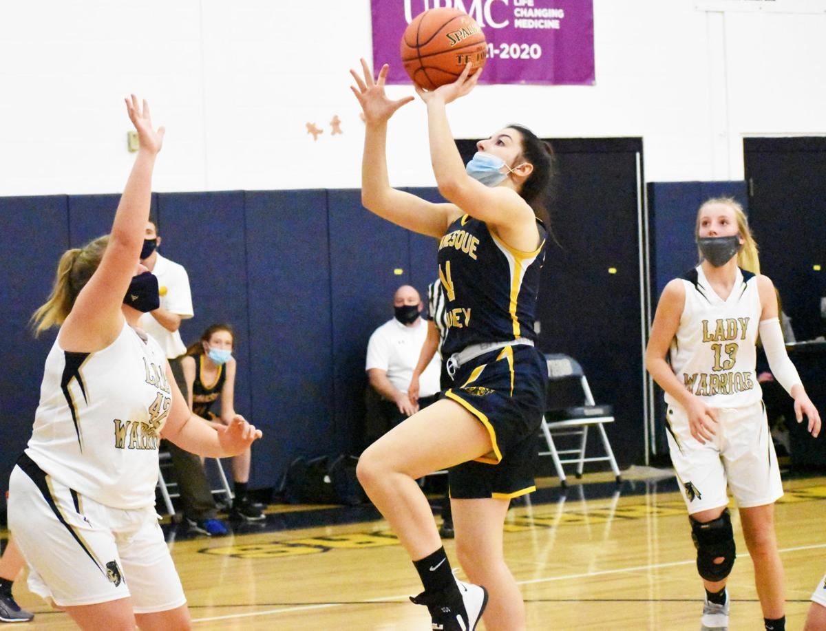Sarine goes up for basketball