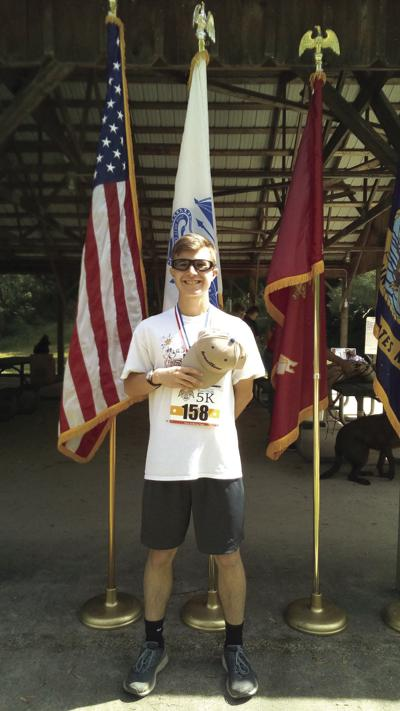 Matt Garis finishes first at Armed Forces 5K