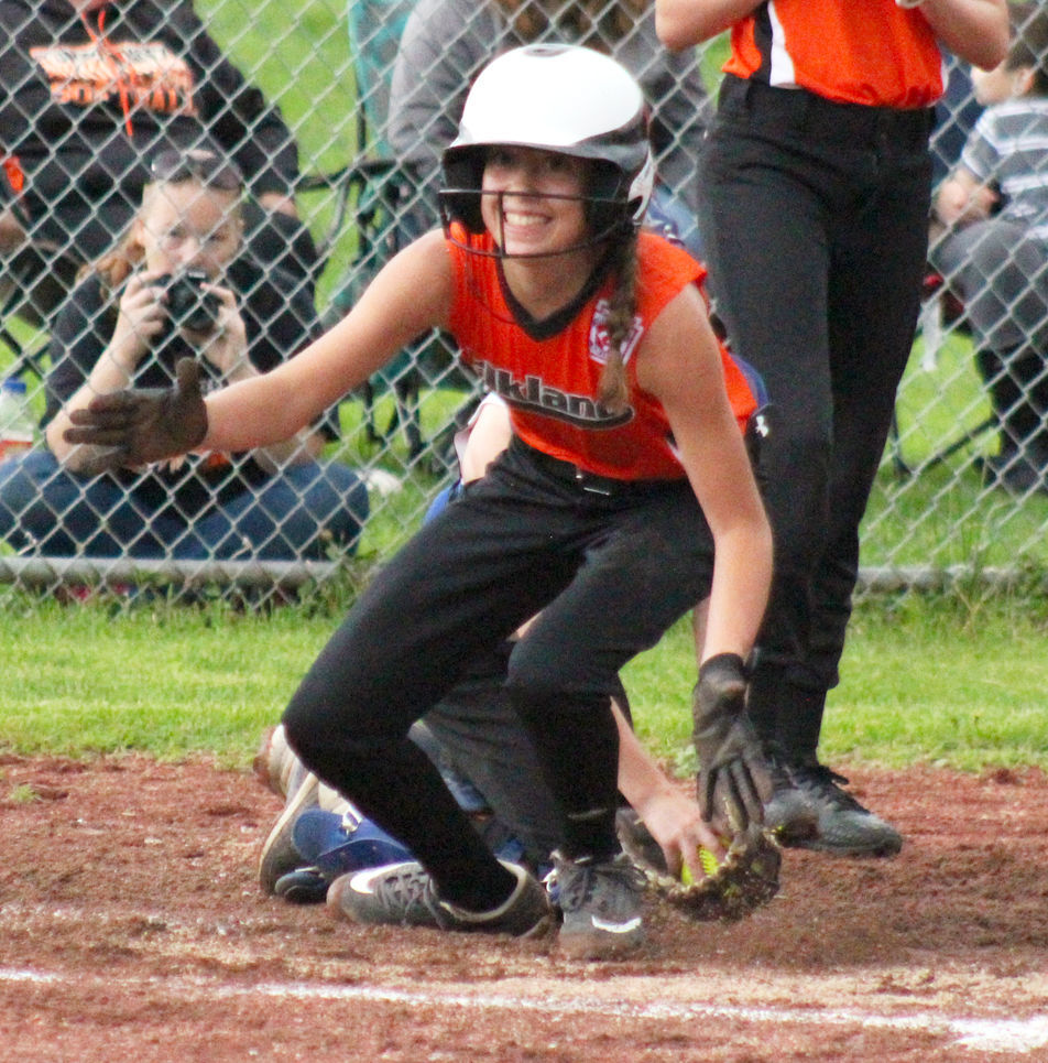 Kyra Daley slides safely into home