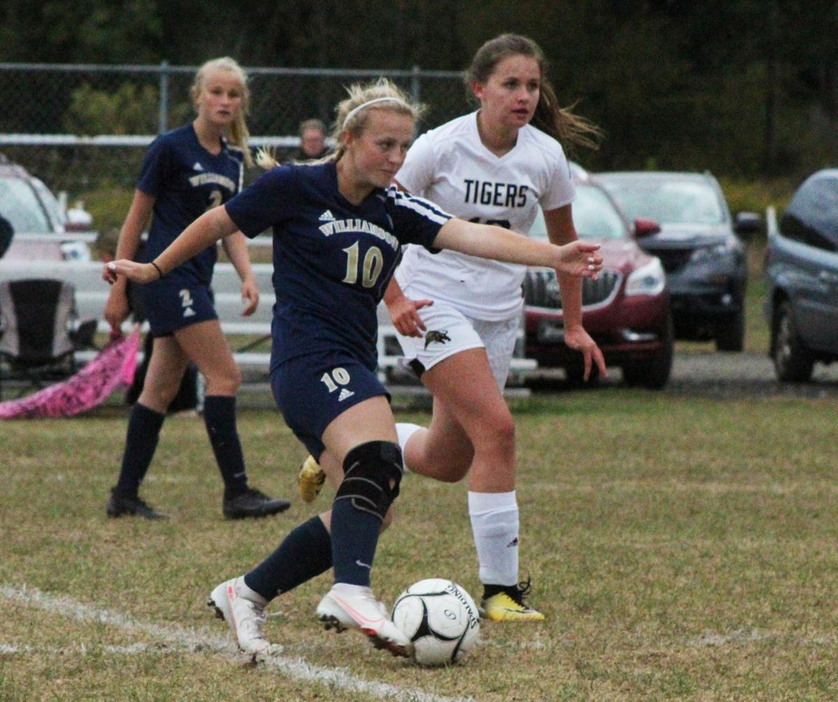 Maddison Hozey controls the ball