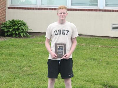 Brandon Thompson receives Tioga Publishing Defensive Player of the Year award