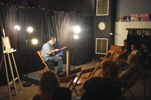 <p>Titusville resident Michael Garfinkel reads poetry at the Oil Region Coalition of Artists' open mic night on Friday, at Savory Studio in Titusville. The event has run for nearly three years, held on the fourth Friday of every month, and has seen a growth of interest in that time.</p>