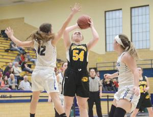 """<p class=""""p1""""><strong>Maplewood's Isabelle Snyder (54) scored a team-high 19 points to lead the Tigers past Reynolds, 49-41, in Saturday's District 10 Class 2A Quarterfinal at Farrell High School.</strong></p>"""