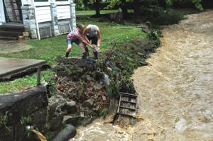 Local waterways flood into yards and basements, power outages reported