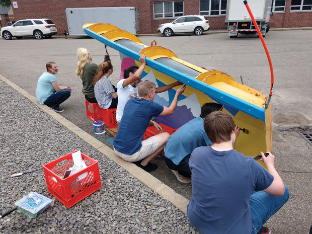 Students working on plow