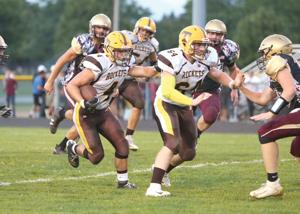 Rockets outlast Grape Pickers, 28-27, in OT