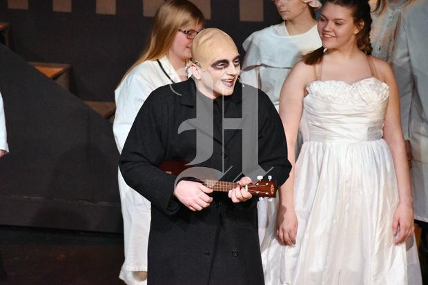 Uncle Fester plays his ukulele