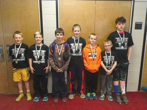 <p>From left: Coleman Huck, Jaxon Covell, Nate Stearns, Brock Covell, Trenton Rodgers, Ian Stearn, and Jesse Schmidt are the seven wrestlers that qualified for the PA Junior Wrestling Championships on Friday and Saturday.</p>