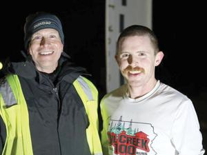 "<p class=""p1""><strong>Pittsburgh resident Cameron Stauffer (right) poses with OC100 Race Director Tom Jennings after setting a new record in the 100-mile race on Saturday.</strong></p>"